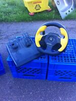 Game steering wheel and foot pedals
