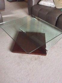 Glass coffee table on mahogany base