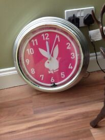 Pink Play Boy Illuminating Wall Clock.