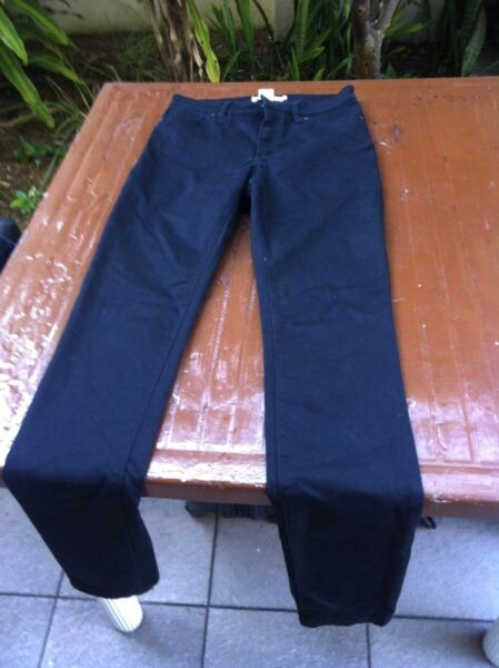 H&M black jeans stretchable Size EU 38.   In good condition.