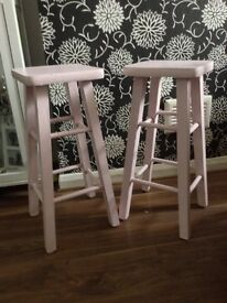 Two Pink Wooden Stools