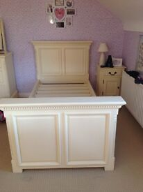 Solid wooden cream painted single bed. Wooden slats