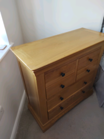 Solid Oak bedside cabinet and 6 drawer oak cabinet