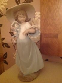 NAO ORNAMENT, LADY HOLDING BABY WITH BASKET