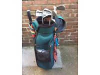 Set of hippo golf irons and hippo trolley bag.