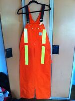 Brand new Carhartt size small orange and yellow safety overalls