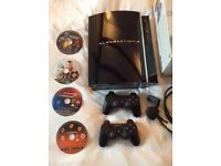 Sony PS3 with two controllers and four games