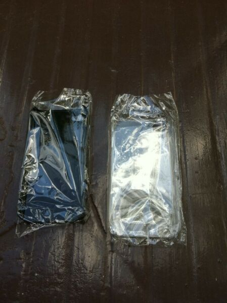 Two Brand new Iphone 4 covers black and transparent colour.