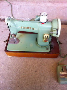 Singer Featherweight compact sewing machine.