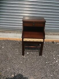 Telephone table with upholstered pull out seat