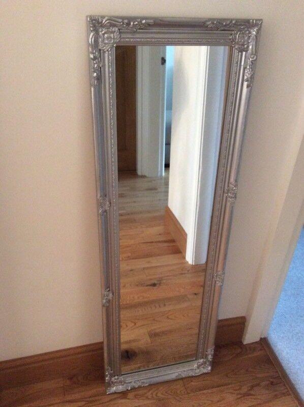 Silver ornate wall mirror