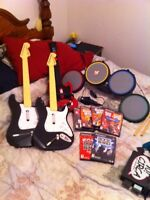 *NEW PRICE* Ps2 with Guitar Hero and Rockband games