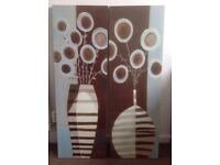 2 canvas prints of flowers in vases