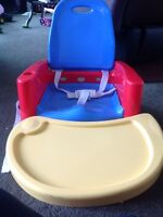 The First Years Booster Seat with swing tray