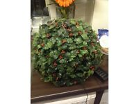 Xmas solar powered plastic holly ball .