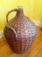Enormous wicker covered glass bottle