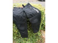 Swift waterproof textile trousers.size medium