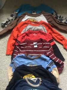 9 long sleeve shirts. Size 24 months