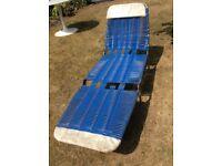 Vintage blue and white plastic sun lounger