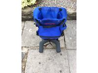 Child carrier backpack with built in stand.