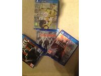 PS4, two controllers and 4 games for sale.