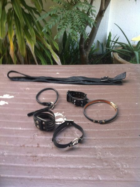 One Black belt and 5 bracelets of various designs. In good condition.