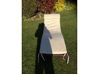 Rattan sun lounger with washable cream cushion