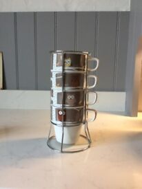 Unused - Set of four NEXT mugs in stand