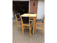 Tall oak table and four chairs