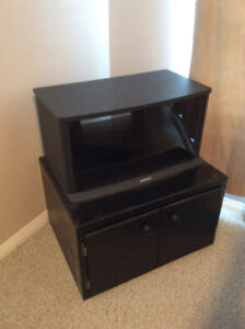 Tv stand and cabinet for storage.
