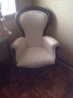 Elegant ivory wing chair with coffee table