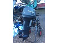 Tohatsu outboard 70 hp long Shaft power trim and tilt on remotes
