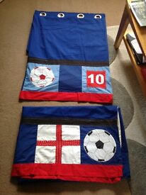 A pair of next boys football curtains in good condition.