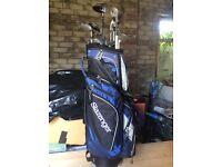 Titleist golf clubs and Slazenger bag