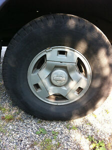 Set of 4 Nissan pathfinder stock rims with 31X10.5X15inch tires