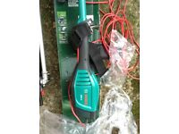 Bosh AMW 10 long reach hedge trimmer and chainsaw