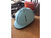Blue adjustable horse riding hat and reversible body warmer