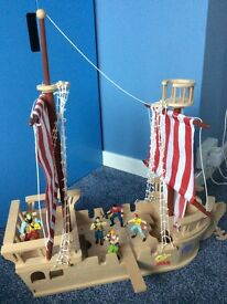 Wooden pirate ship with toy pirates