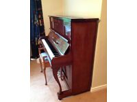 Upright Schmidt piano with stool