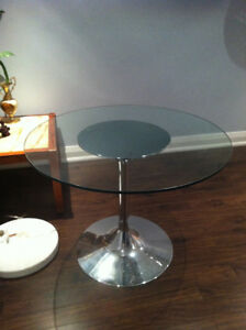 Tulip table- chrome base glass top.