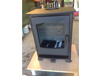 NEW/UNUSED WOOD BURNING STOVE