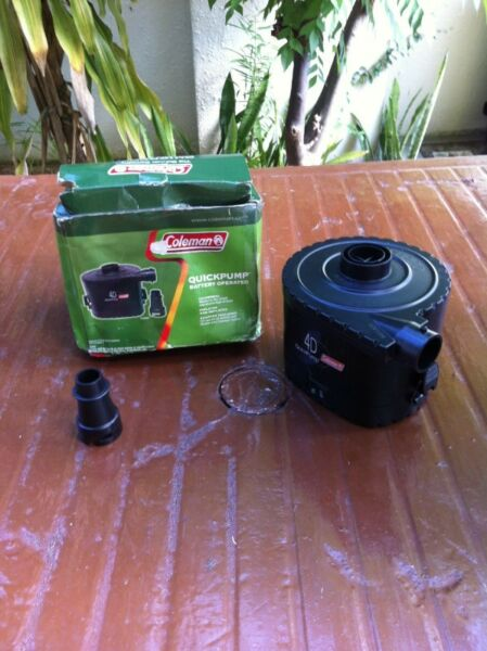 Coleman quick air pump battery operated with four batteries. In good working condition.