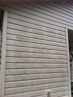 Exterior siding wash by hand with brush