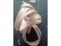 Peach straw, feather and beads fascinator