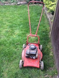 Four wheeled petrol lawnmower