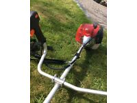 Petrol strimmer and brush cutter