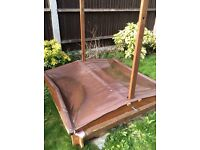 Wooden sandpit with retractable canopy £20