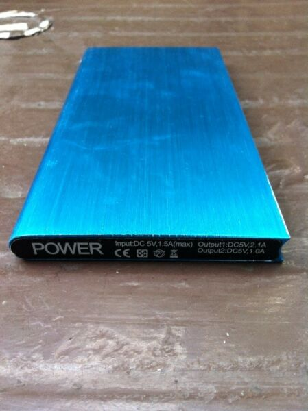 Power bank. Capacity 20000 mah. Size 15 x 7.5x 0.8cm,  In good working condition.