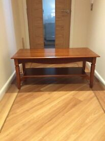 Coffee table with shelf beneath in rosewood