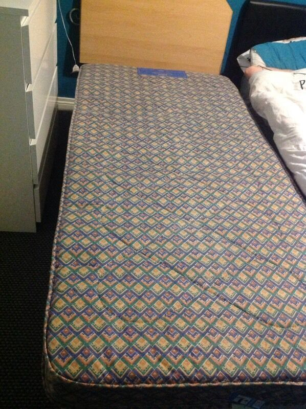Single divan bed with mattress and head board
